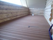 Террасная доска для бревенчатого дома на лоджию