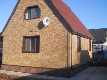 Облицовка загородного дома сайдингом Nailite серии Stacked Stone
