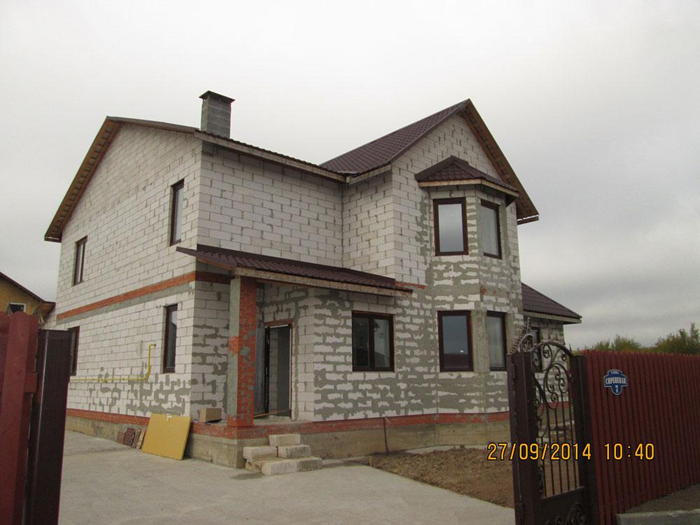 Фото нового блочного дома до отделки фасада